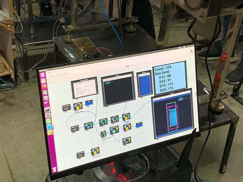 นักวิจัยสกสว.ใช้ AI ตรวจสอบคุณภาพการผลิตหน้ากากอนามัยในโรงงาน CP